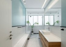 Contemporary bathroom in white and light blue with ample natural lighting