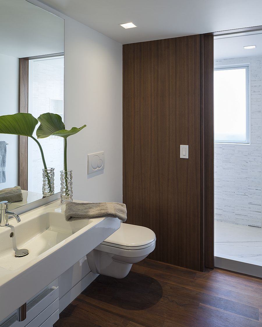Contemporary bathroom in white with sliding wooden doors