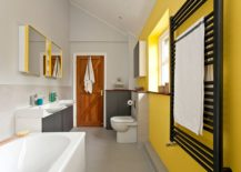 Contemporary bathroom in yellow and gray with ample natural light