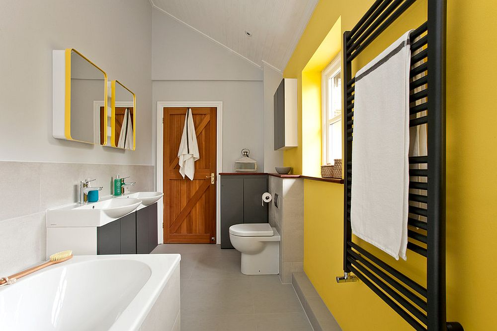 Contemporary bathroom in yellow and gray with ample natural light [Design: InStil Design Limited / Photo: Fraser Marr]