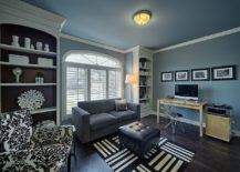 Contemporary home office in blue and gray with ample shelf space