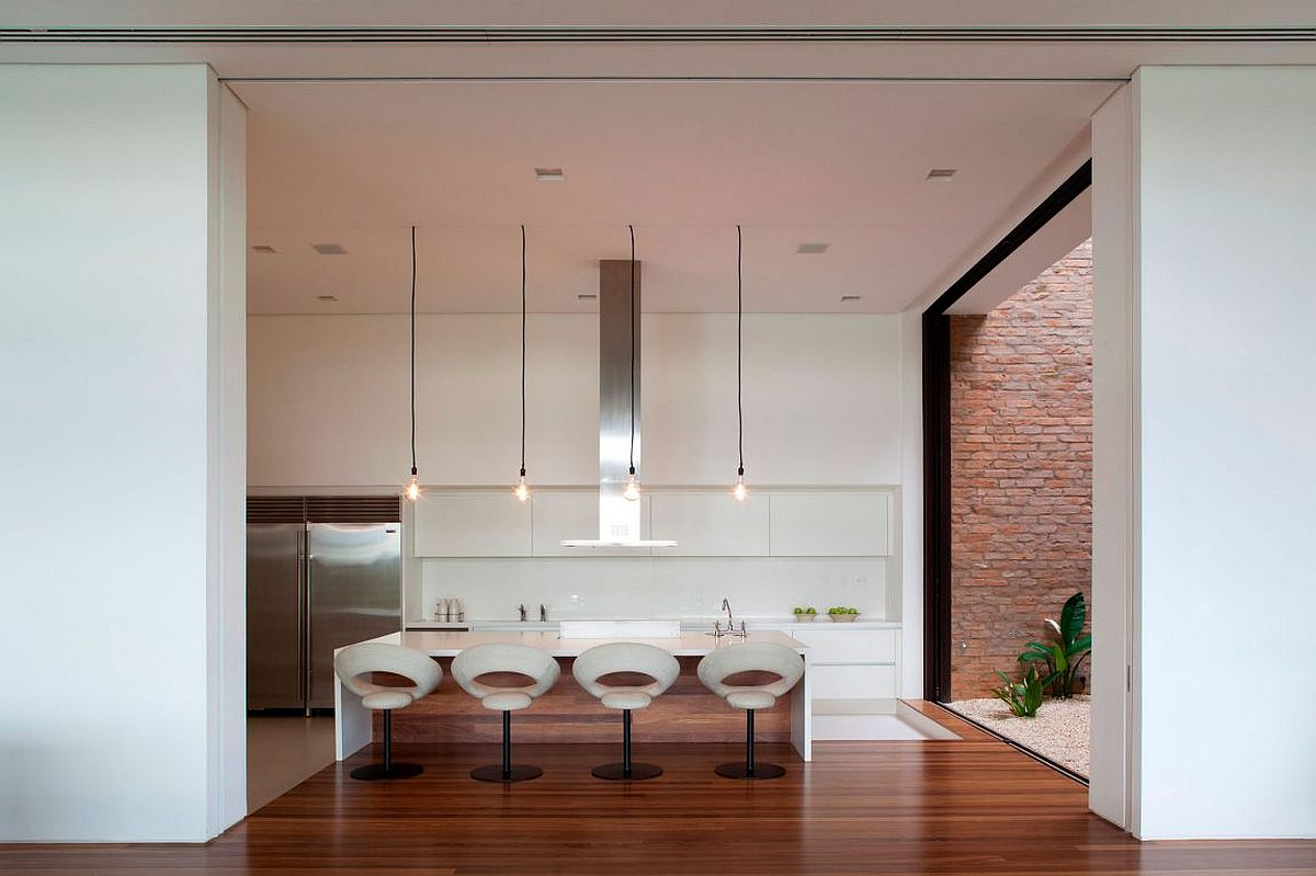 Contemporray kitchen in white with Edison bulbs above the island