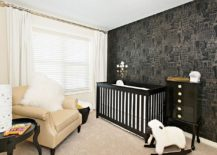 Cool wallpaper, crib and decor bring black to the white nursery