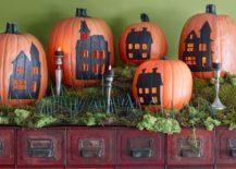 Create an entire haunted village with carved pumpkins