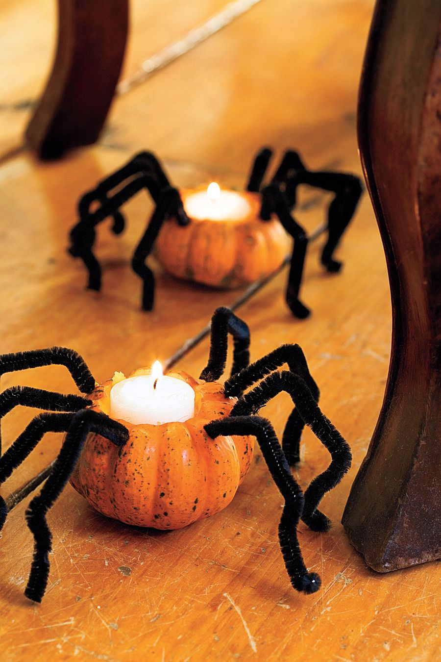 Creepy spider pumpkins with candles combine spooky design with lovely lighting