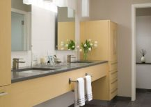 Custom designed cabinets bring yellow to the contemporary bathroom