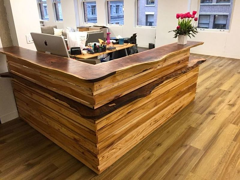 Custom reception desk in natural wood with live edge finish for home office [Design: Design Trifecta Woodwork]