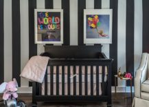 Custom striped accent wall in black and white and crib in black for the chic contemporary nursery