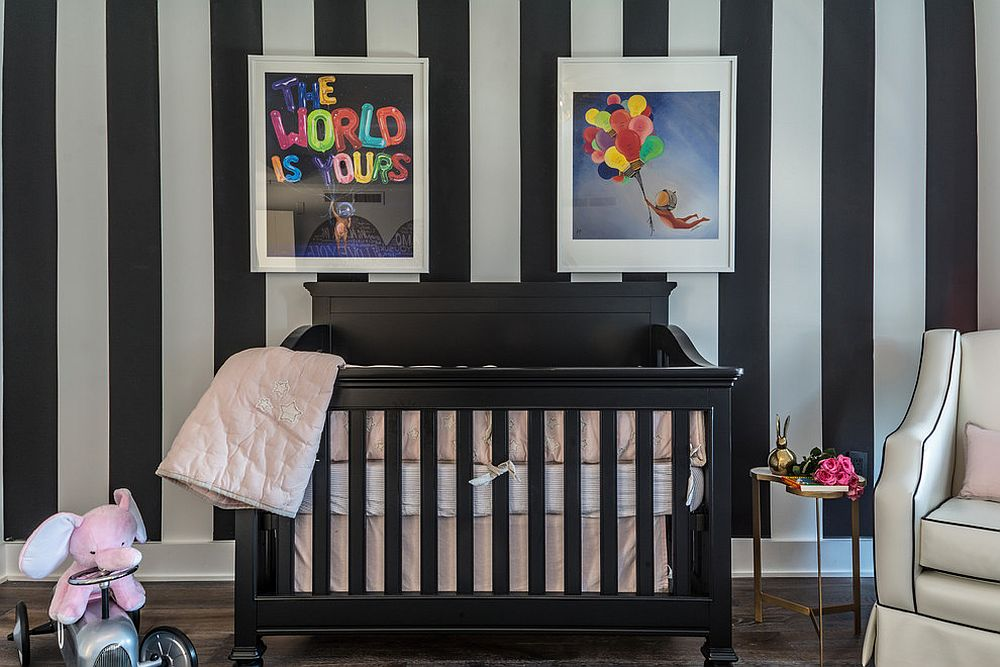 Custom striped accent wall in black and white and crib in black for the chic contemporary nursery [Design: CD Interiors / Gerard Garcia]