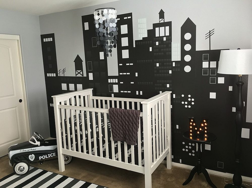 Custom wall mural in the nursery depicts a bright city skyline [Design: Anita Roll Murals]