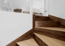 Custom walnut oak staircase connecting the living area with mezznine level master bedroom