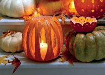 DIY decorative votive holders carved from pumpkins for Halloween