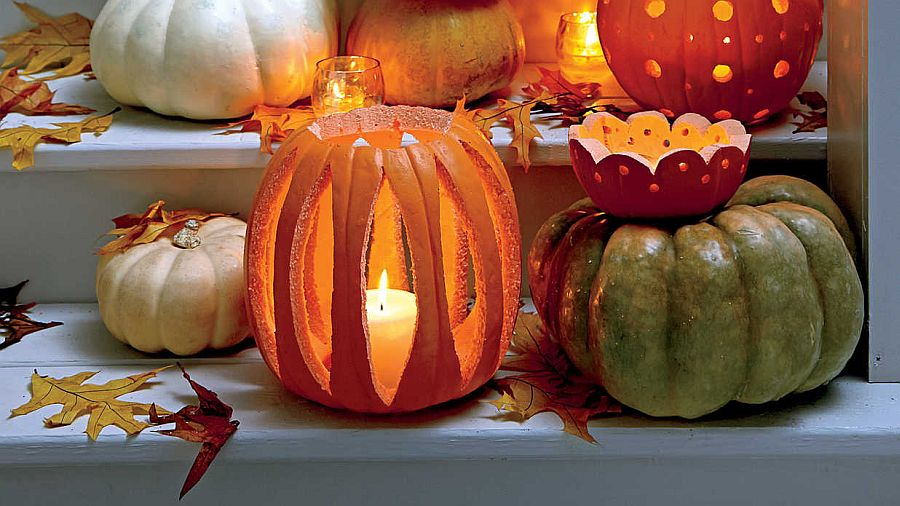 DIY decorative votive holders carved from pumpkins for Halloween [Photo: Laurey W. Glenn]