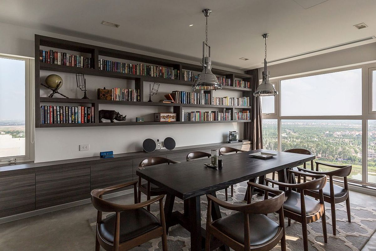 Dark gray cabinets and dining table for the dining room that also serves as home library