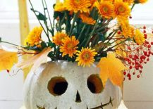 Delightful way to combine colors of fall with pumpkin carving