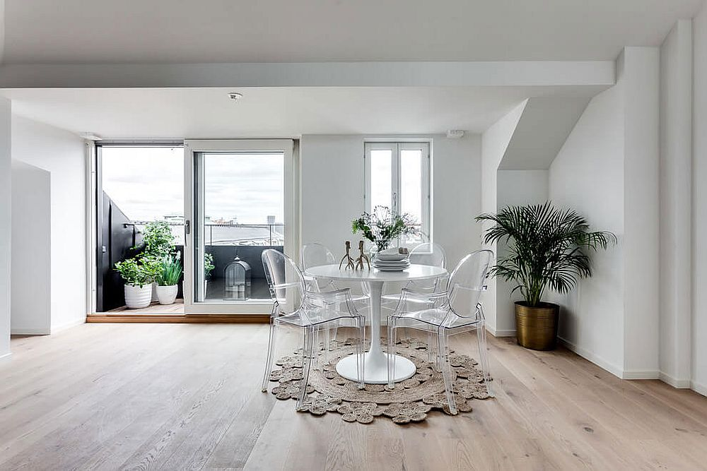 Dining area and balcony of the small attic apartment in Stockholm