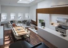 Double height open living area of the NoHo loft with dining area and kitchen