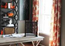 Drapes and rug bring orange to the home office in gray