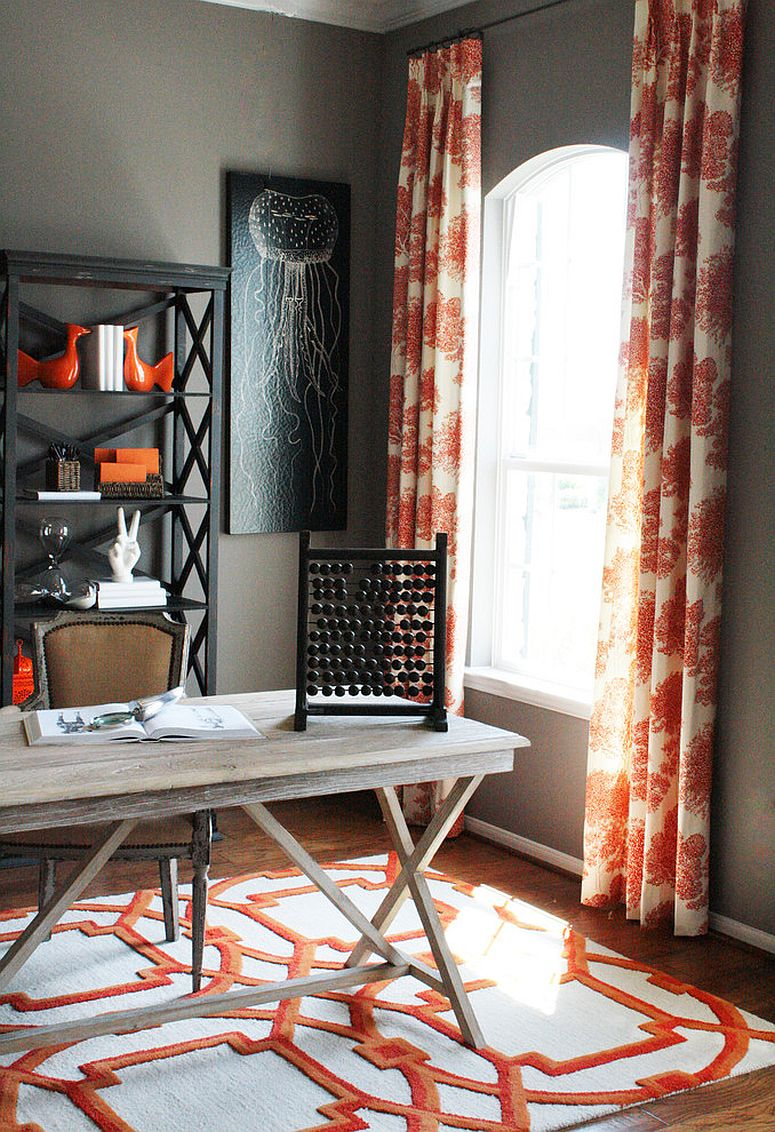 Drapes and rug bring orange to the home office in gray [Design: Cristi Holcombe Interiors]