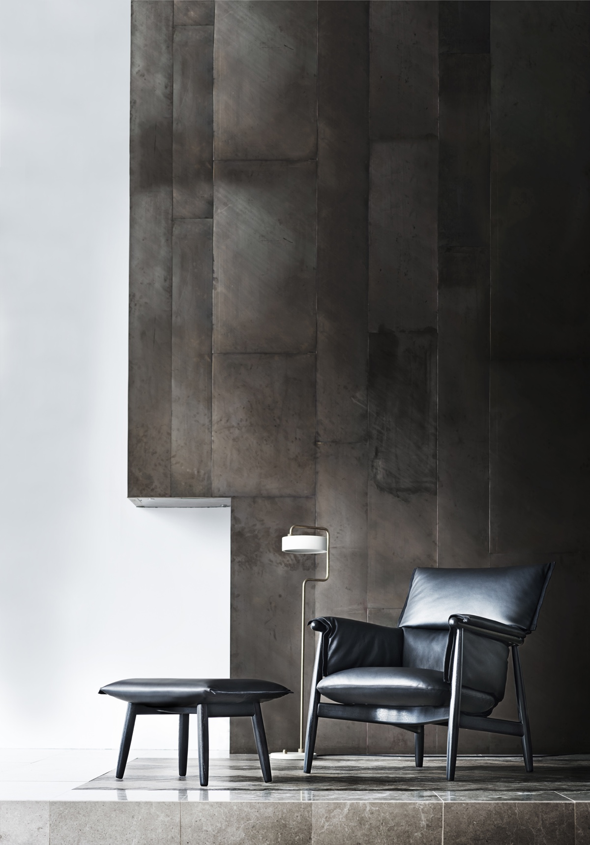 EOOS Embrace Lounge Chair in black oak and leather.