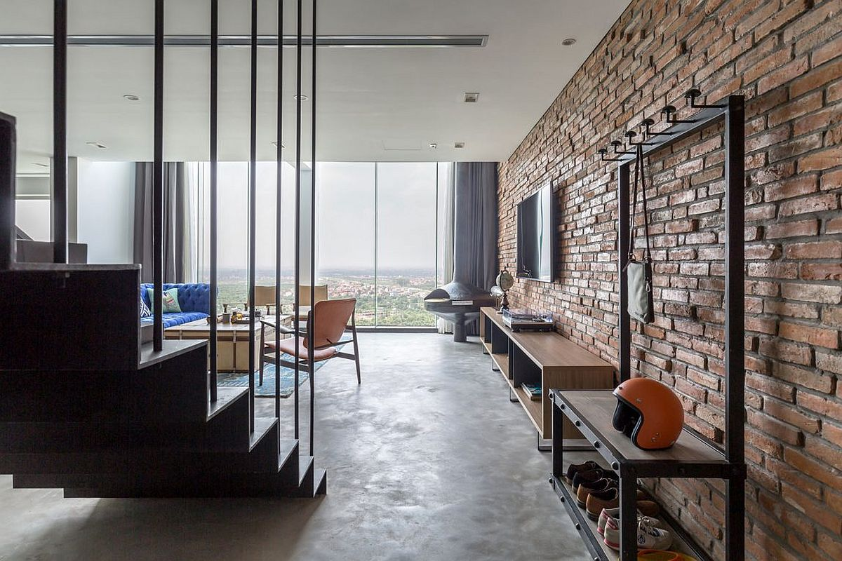 Exposed brick wall gives the living room an industrial appeal