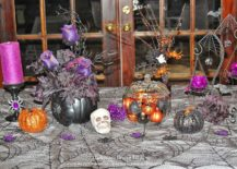 Exquisite and fun Halloween table decoration with black pumpkins and floral centerpiece