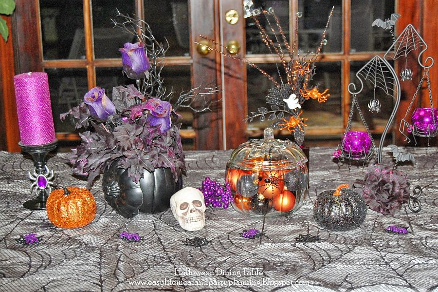 Exquisite and fun Halloween table decoration with black pumpkins and floral centerpiece [From: Easy Life Meal & Party Planning]