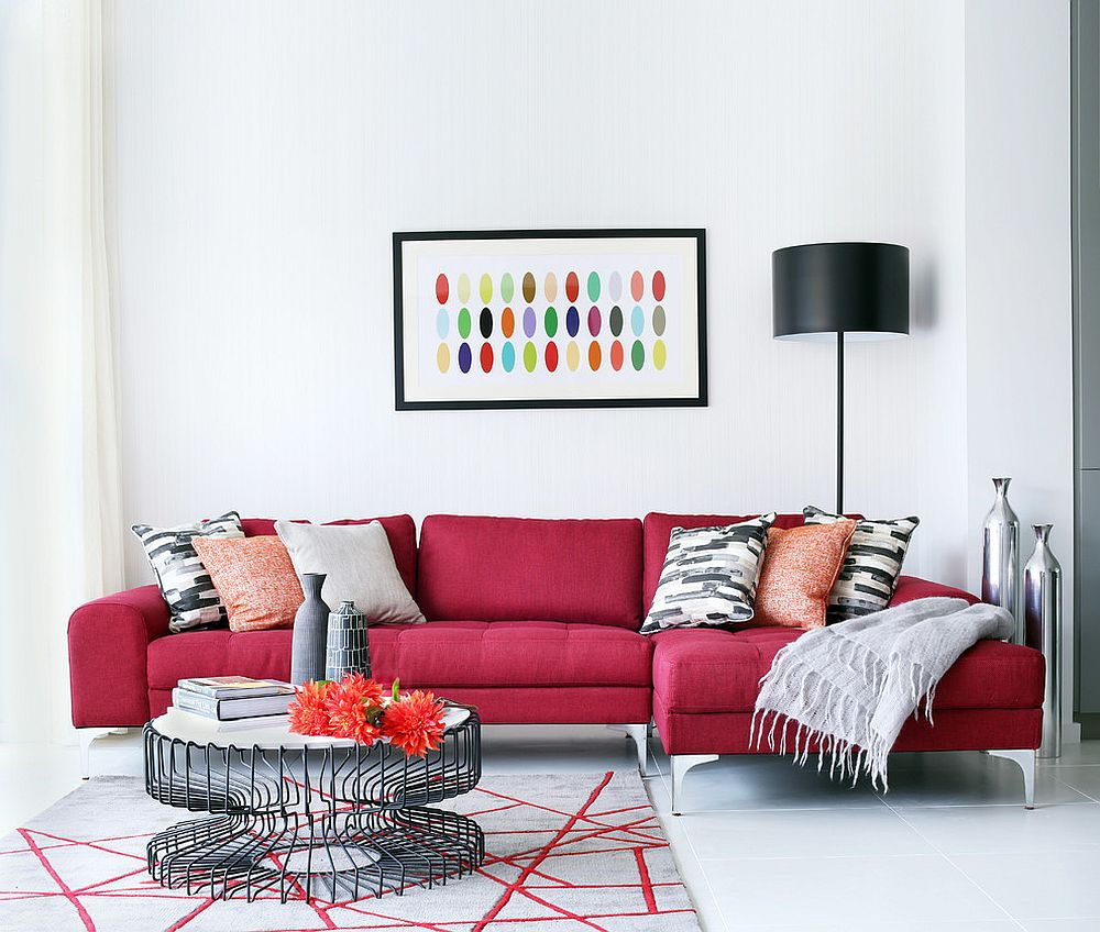 Exquisite dark red sofa brings vivaciousness to the white living room [From: Alex Maguire Photography]