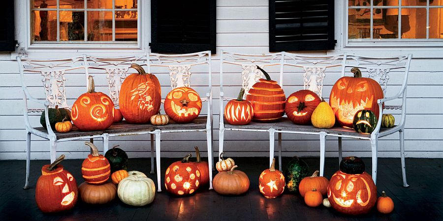 Fabulous lineup of carved pumpkins coupled with cool lighting