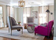 Fabulous sofa in bright fuchsia adds color and cheerful glam to the living room in gray