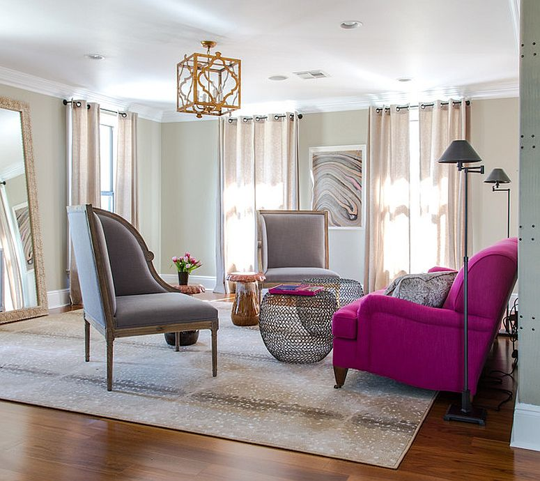 Fabulous sofa in bright fuchsia adds color and cheerful glam to the living room in gray [Design: Valorize Hart]