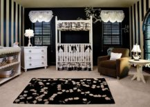 Fabulous transitional nursery in black and white with striped walls and black rug