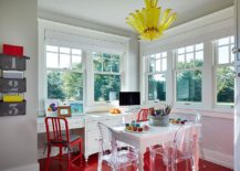 Flooring and chair enliven the gray home office with a splash of red
