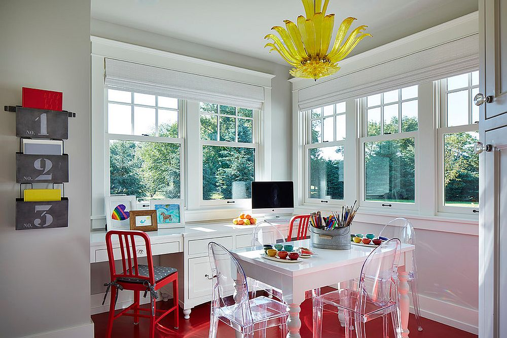 Flooring and chair enliven the gray home office with a splash of red [Design: Martha O'Hara Interiors]