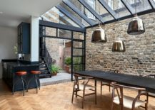 Framed-glass-doors-and-a-steel-structure-give-the-Victorian-London-home-a-smart-modern-vibe-217x155