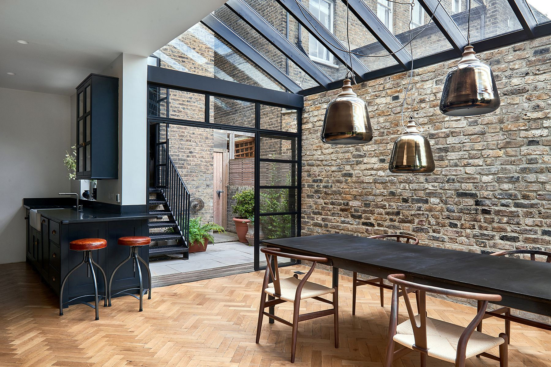 View In Gallery Framed Glass Doors And A Steel Structure Give The Victorian London Home Smart Modern Vibe