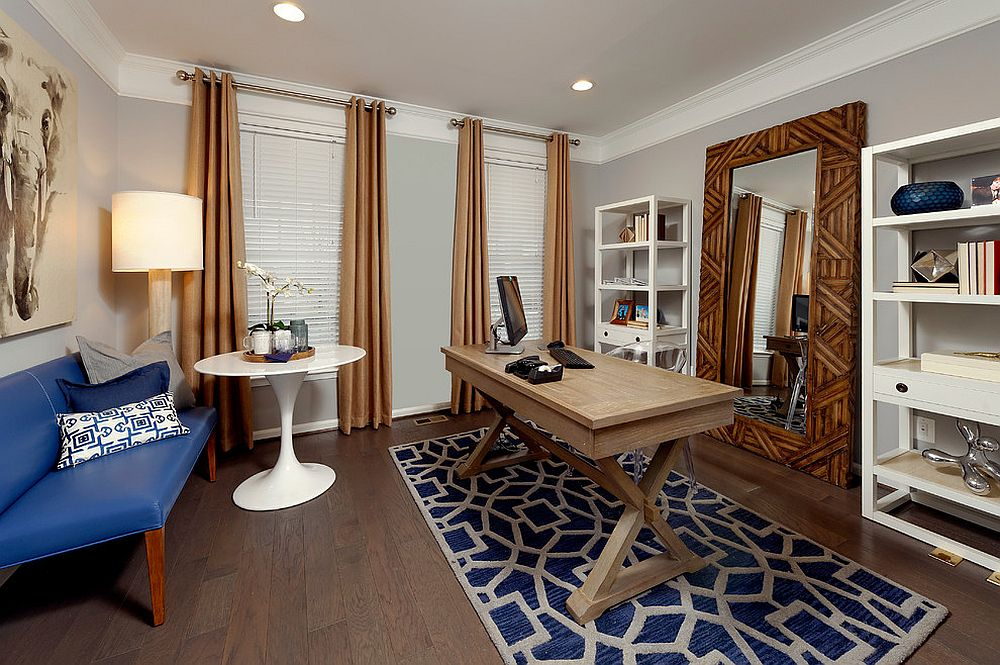 Giant mirror and a small coffee zone set this home office apart from the usual