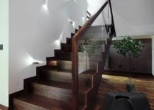 Glass-and-wood-staircase-adds-sculptural-beauty-to-the-smart-home-in-Latvia-217x155