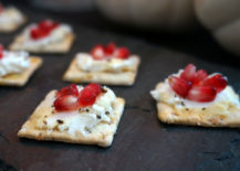 Goat cheese crackers with pomegranate and honey