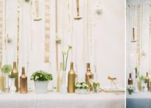 Gold wine bottle and milk glass centerpiece