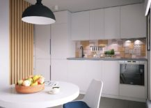 Small kitchen with unique tiled backsplash