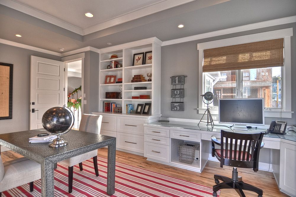 Gorgeous striped rug in red brings color to this traditional home office in gray [Design: LuAnn Development / Photography: Bowman Group]