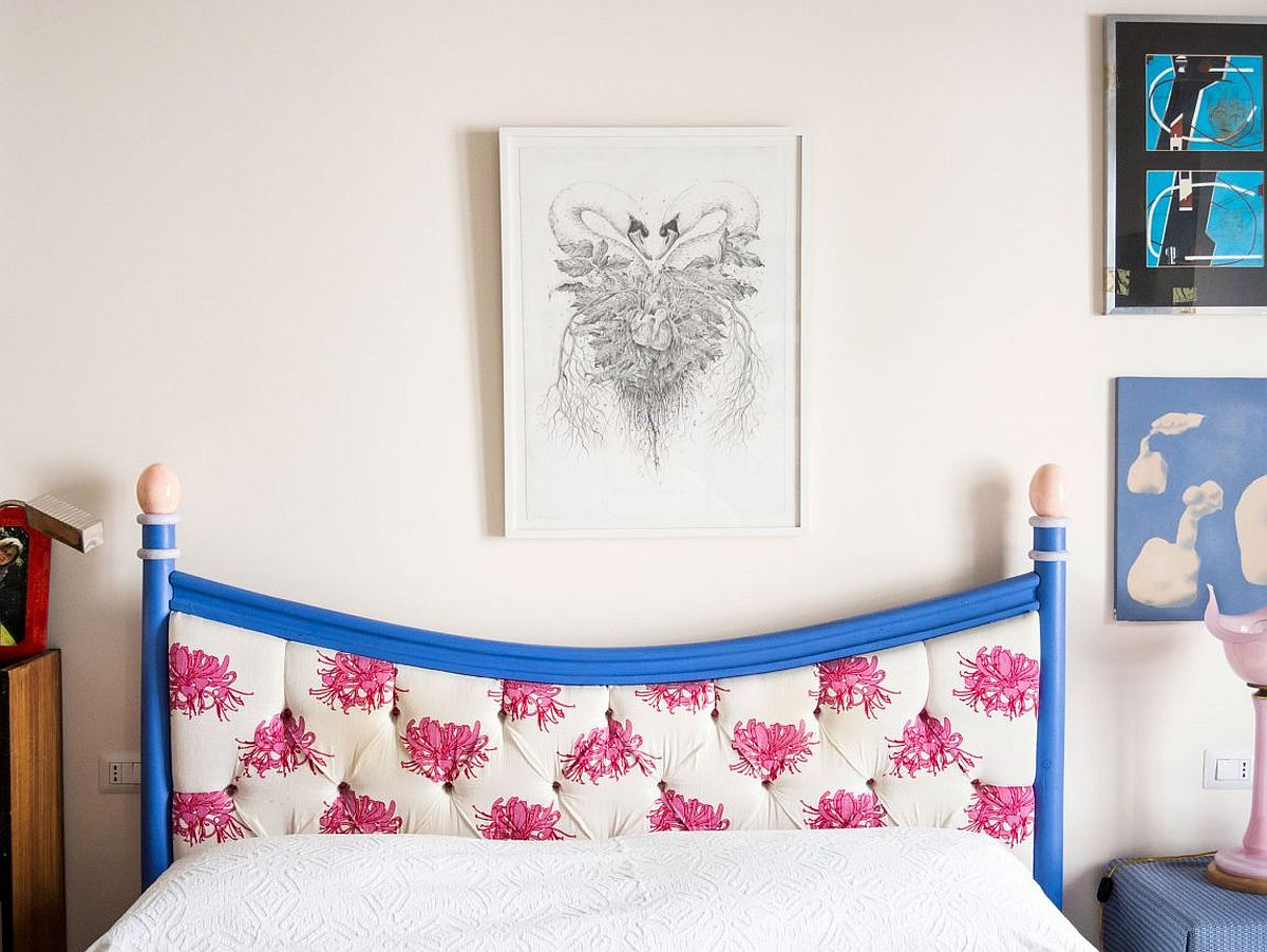 Gorgeous tufted headboard in blue with pops of fuchsia
