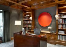 Gray upholstered walls are brought alive with unique orange artwork addition