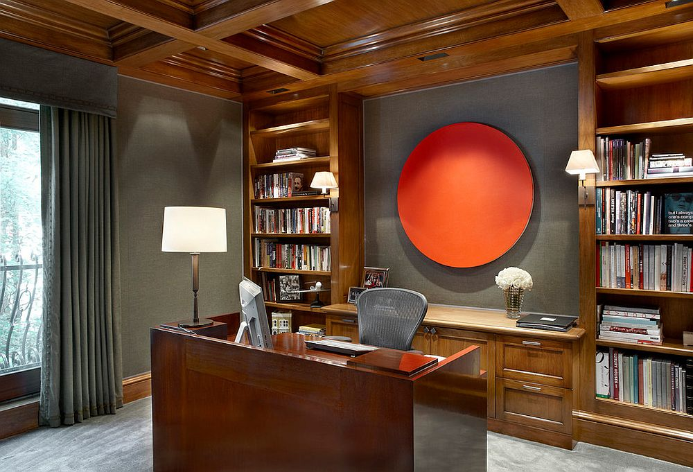 Gray upholstered walls are brought alive with unique orange artwork addition [Design: Scott Himmel Architect]