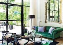 Green in the rug complements that of the couch perfectly