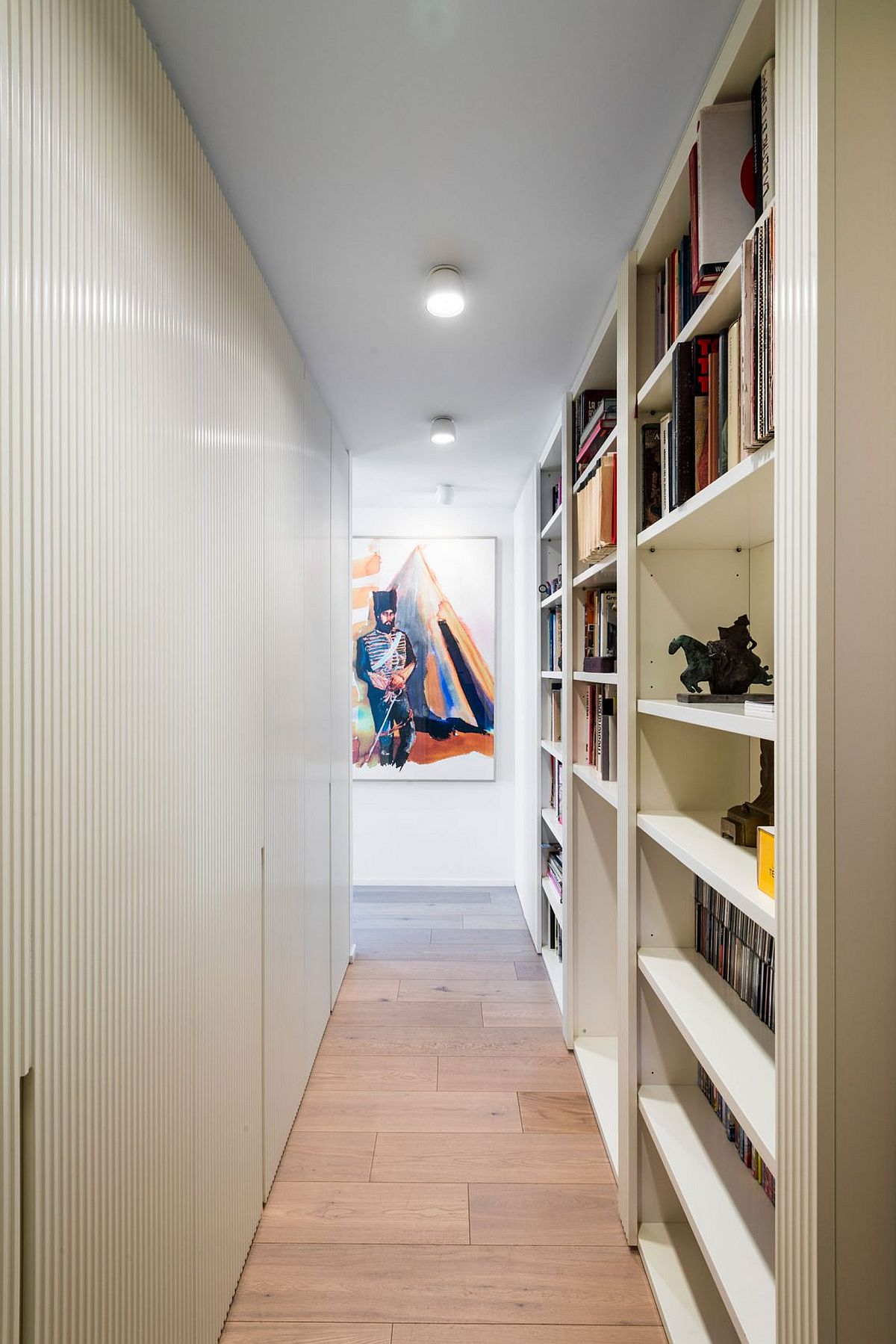 Hallway and corridor with bookshelves offers additional storage space