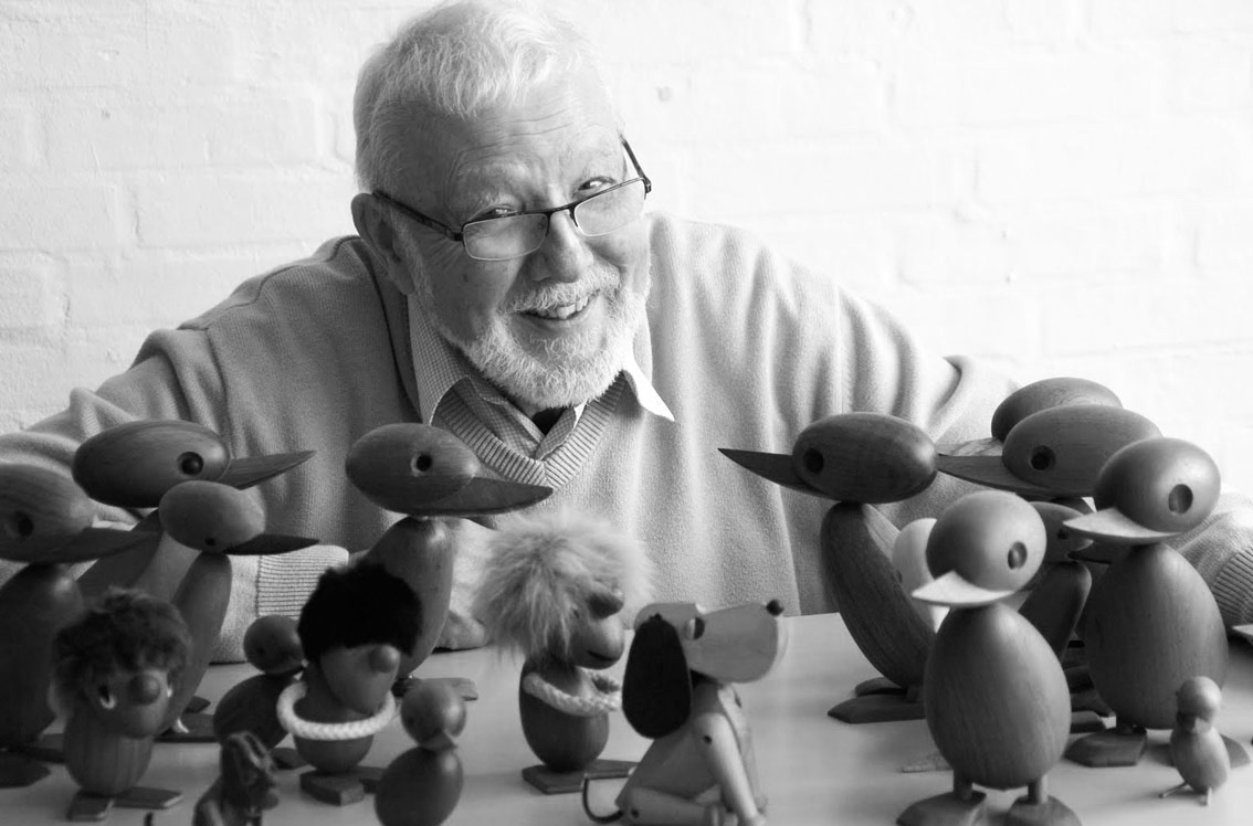 Hans Bølling with his wooden creations. Image via Rosborg Møbler.