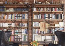 Home library with brick wall backdrop and comfy modern decor