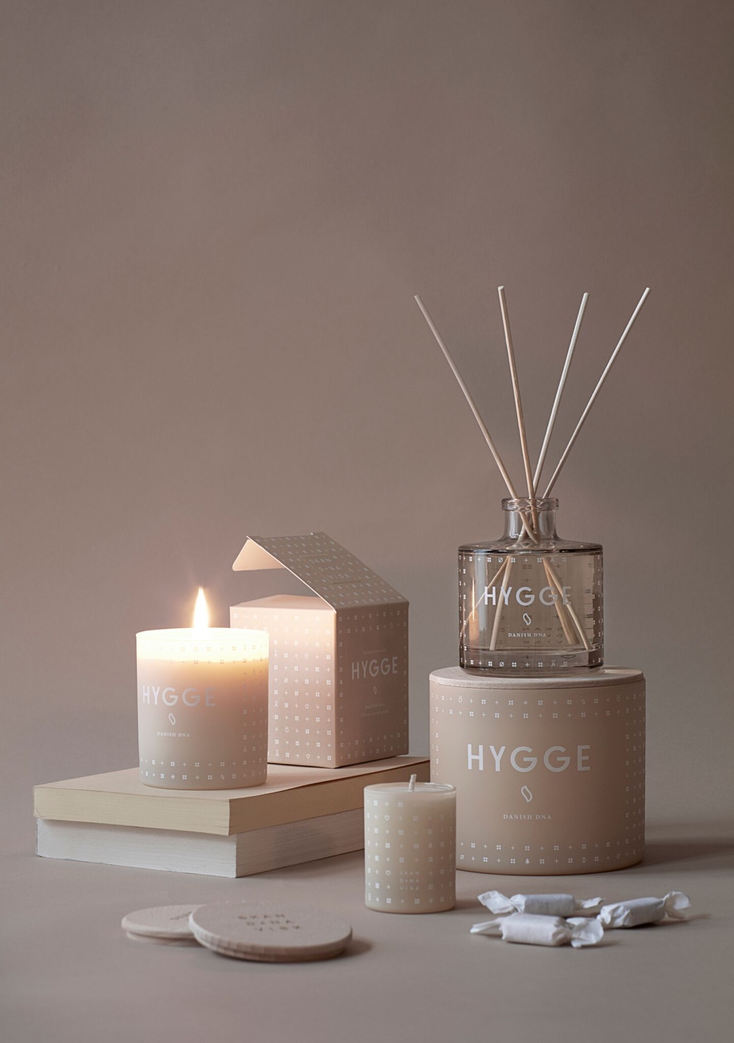 Hygge scented candles and diffuser. Image © 2016 SKANDINAVISK.